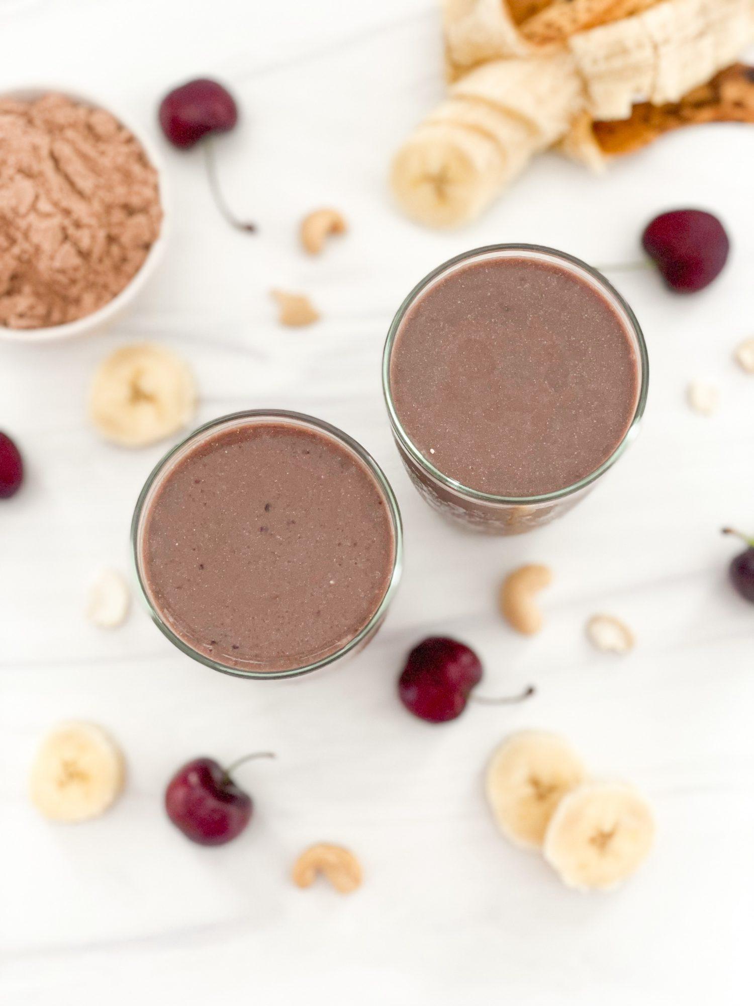 chocolate plant protein, cherry banana protein shake with ingredients around