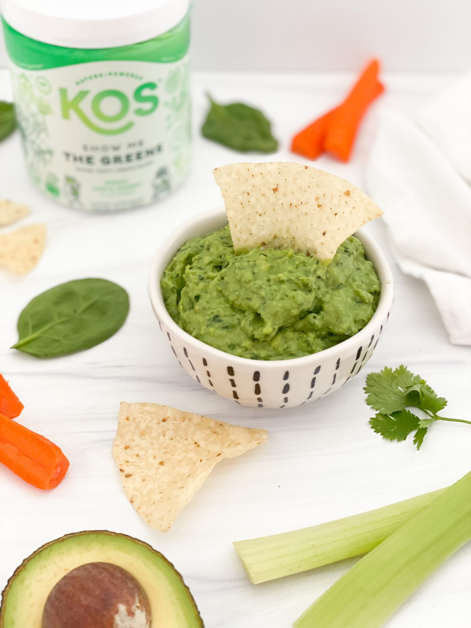 show me the greens chip and veggie dip with ingredients laying around the bowl